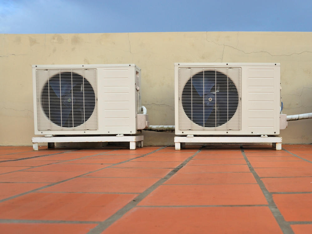 Air conditioners on a building. Scientists say there has been too little research into the role of heating, ventilation and air conditioning systems in the spread of the coronavirus.