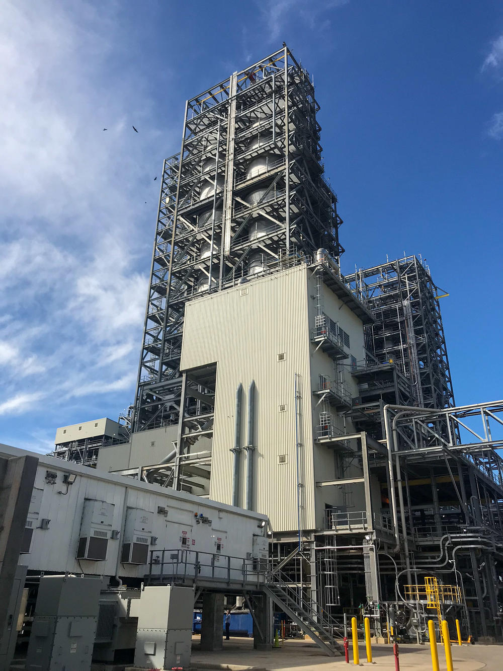 Chevron Phillips Chemical's new $6 billion plastic manufacturing plant rises from the skyline in Sweeny, Texas. Company officials say they see a bright future for their products as demand for plastic continues to rise.