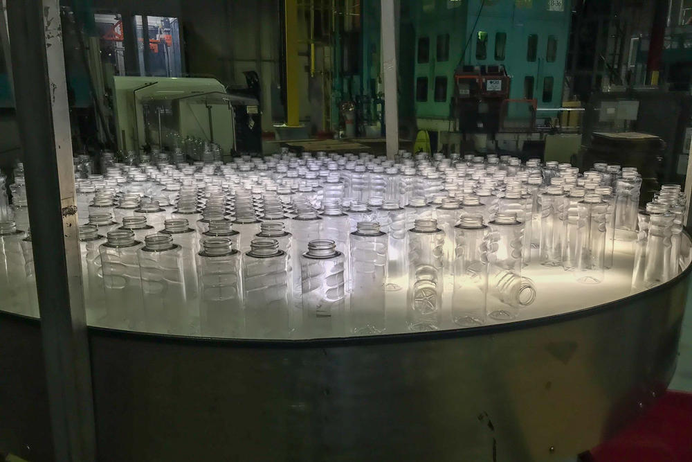 New plastic bottles come off the line at a plastic manufacturing facility in Maryland. Plastic production is expected to triple by 2050.