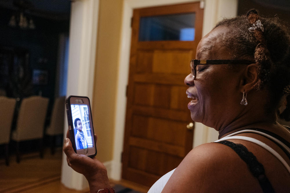 Raymonde Elian talks with her grandson by video call on her day off in May 2020.