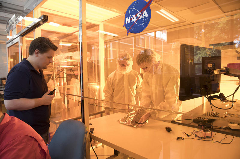 Some students of the 50-member lab test their designs in the clean room.
