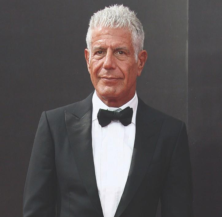The auction features a variety of Anthony Bourdain's personal items. There are carved wooden figures, maps, furniture, books, watches, and even some of his early writings. You can also bid for some of Bourdain's clothing, like his cashmere scarves or his Tom Ford tuxedo, seen here.