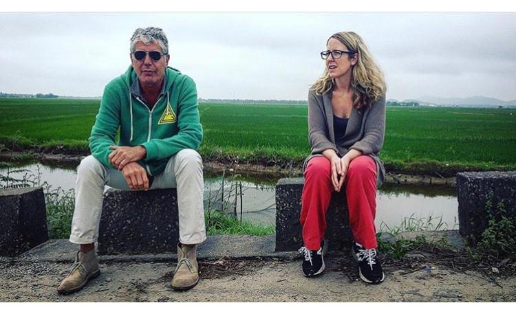 """Laurie Woolever, pictured here with Anthony Bourdain, was his assistant for about a decade, and co-authored his 2016 cookbook """"Appetites."""" She joined """"On Second Thought"""" to share stories of the author, chef, TV host and world traveler."""