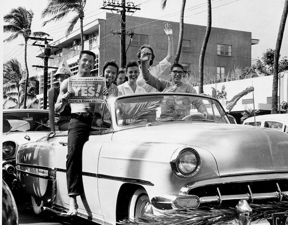 A group of supporters of statehood drive through the street in Waikiki, Honolulu, Hawaii, on March 13, 1959.