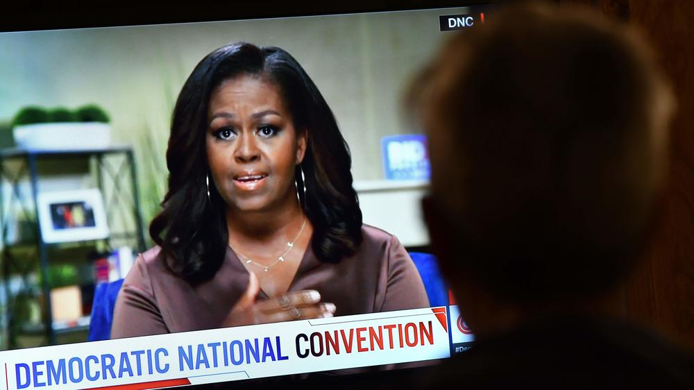 Former first lady Michelle Obama, and her necklace, urged viewers to vote on the opening night of the Democratic National Convention.