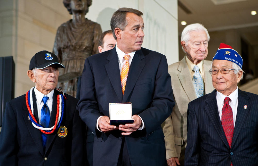 Former Speaker of the House Rep. John Boehner presents the Congressional Gold Medal to Susumu Ito of the 442nd Regimental Combat Team, an Army unit comprised of Japanese Americans from Hawaii which became the most decorated unit for its size and service.