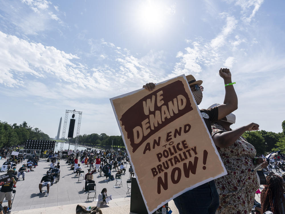People attend the March on Washington, on Friday at the Lincoln Memorial in Washington, D.C., on the 57th anniversary of the Rev. Martin Luther King Jr.'s
