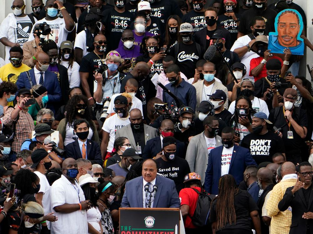 Human Rights Advocate Martin Luther King III, center at bottom, speaks at the Lincoln Memorial during the