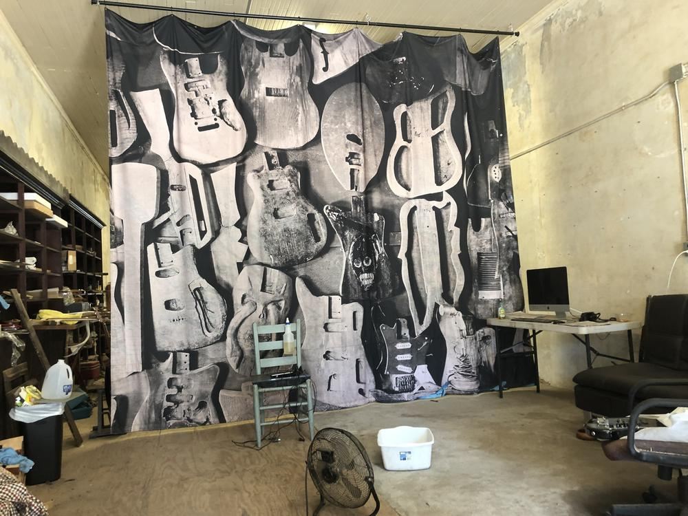 Timothy Duffy's enlarged photo of Freeman Vines' unfinished guitars hanging in Vines' workroom.