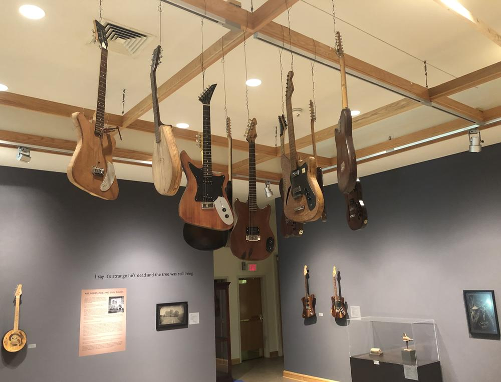 Freeman Vines' guitars hanging in the Greenville Museum of Art.