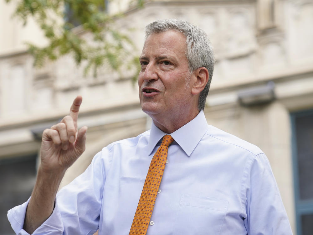 New York City Mayor Bill de Blasio, shown here last month in Brooklyn, says that he and employees in his office will take furloughs to reduce costs.