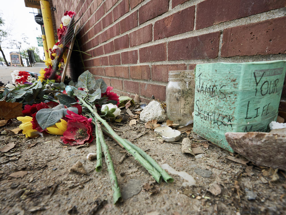 The site of James Scurlock's shooting death in Omaha, Neb., is still being preserved as a memorial in mid-September. On Tuesday, a grand jury indicted Jake Gardner in the killing, handing down four charges including manslaughter.
