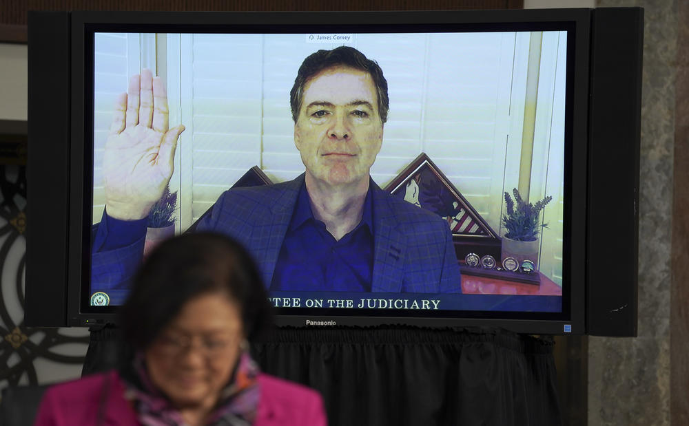 Former FBI Director James Comey is sworn in via videoconference during a Senate Judiciary Committee hearing on Wednesday.