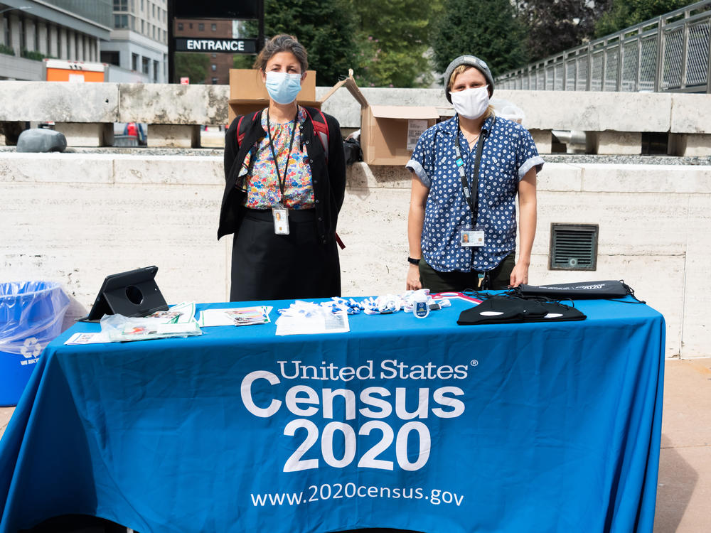 U.S. Census Bureau workers stand outside Lincoln Center in New York City in September. A federal judge has ordered the bureau to keep counting for the 2020 census through Oct. 31 for now.
