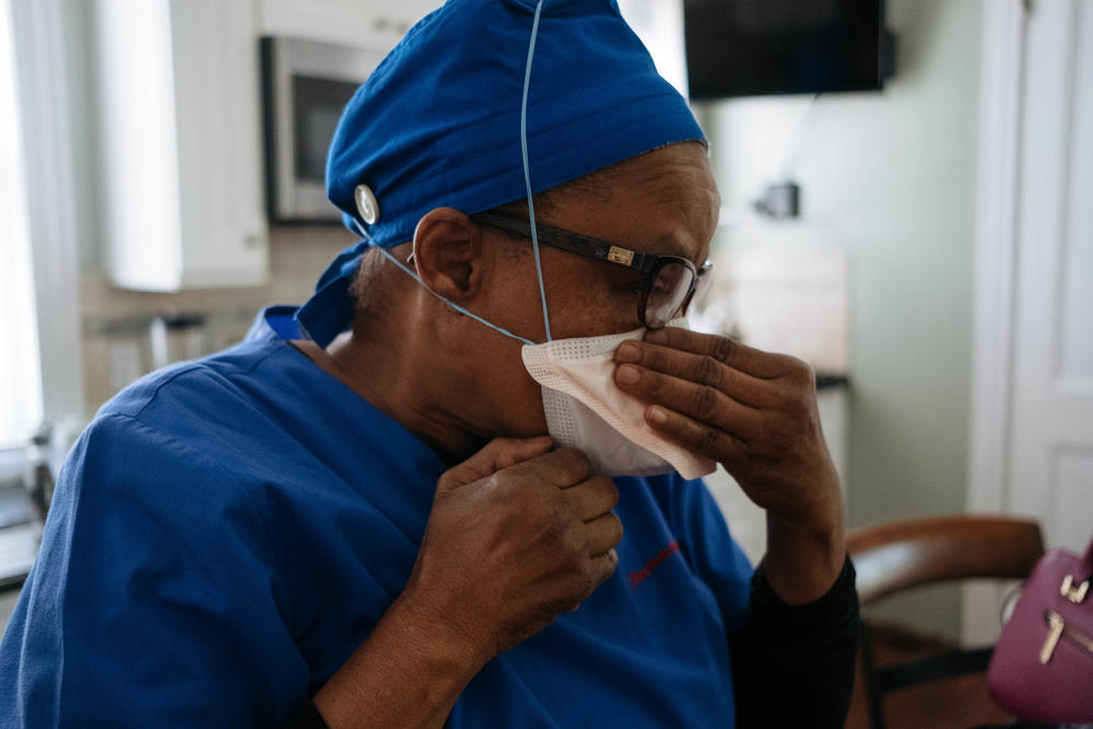 Health care workers were forced to come up with ways to preserve N95 masks. Raymonde Elian wore three masks so that the N95 was less exposed.