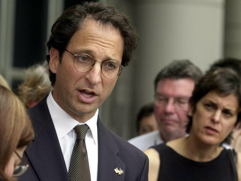 Prosecutor Andrew Weissmann talked with reporters outside the federal courthouse in Houston in 2002. His new book reflects on the past and potential future of the Justice Department.