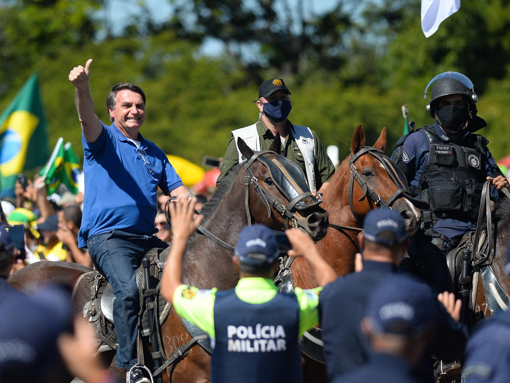 Brazilian President Jair Bolsonaro rides a horse during a May demonstration in favor of his government amid the coronavirus pandemic in front of Planalto Palace in Brasilia.