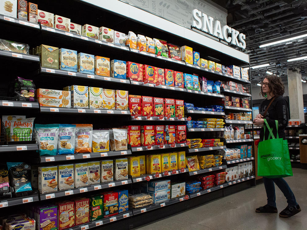 A pre-pandemic Seattle supermarket boasts row after row of prepackaged snacks. Even before the coronavirus pandemic put extra stress on grocery workers, keeping shelves stocked with the variety that Americans have come to expect took a hidden toll on producers, distributors and retail workers, says author Benjamin Lorr.