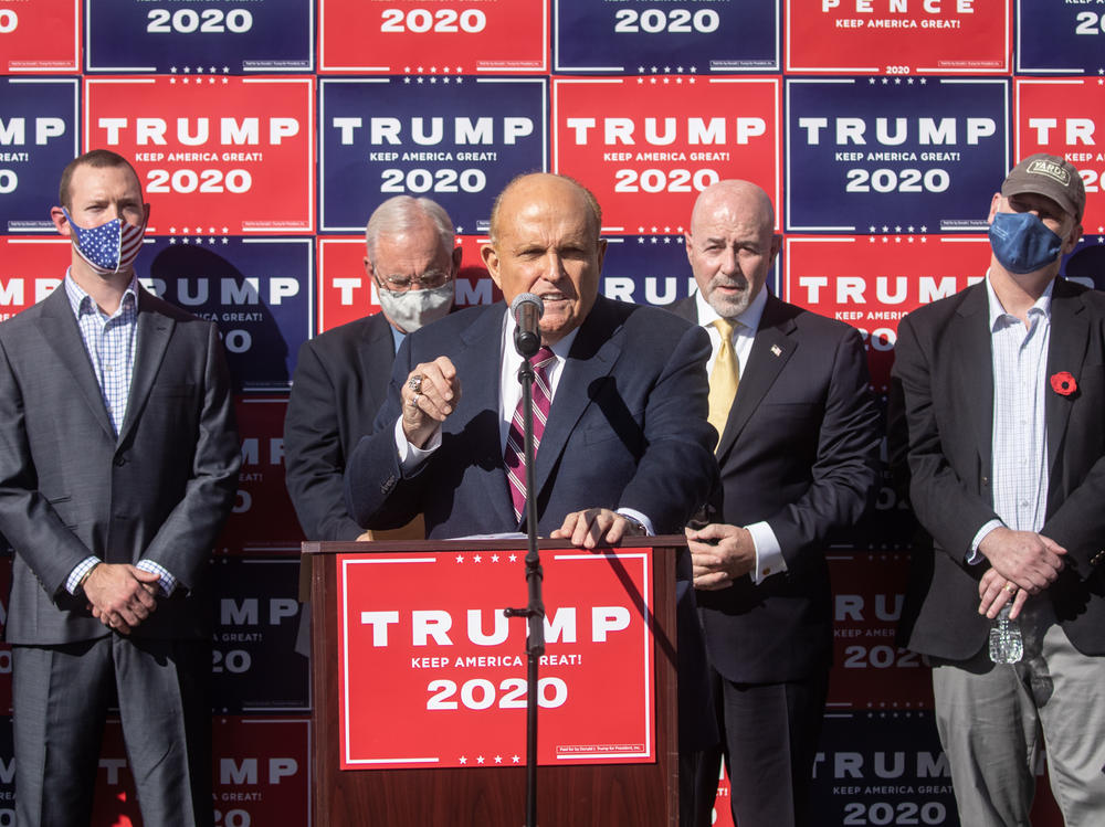 Attorney for the president Rudy Giuliani speaks to the media at a press conference held in the back parking lot of a landscaping company over the weekend in Philadelphia.
