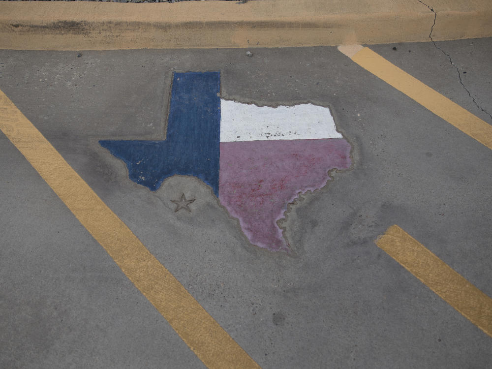 A map of Texas is displayed on a parking spot at the Old Glory Memorial in El Paso, Texas, last year.