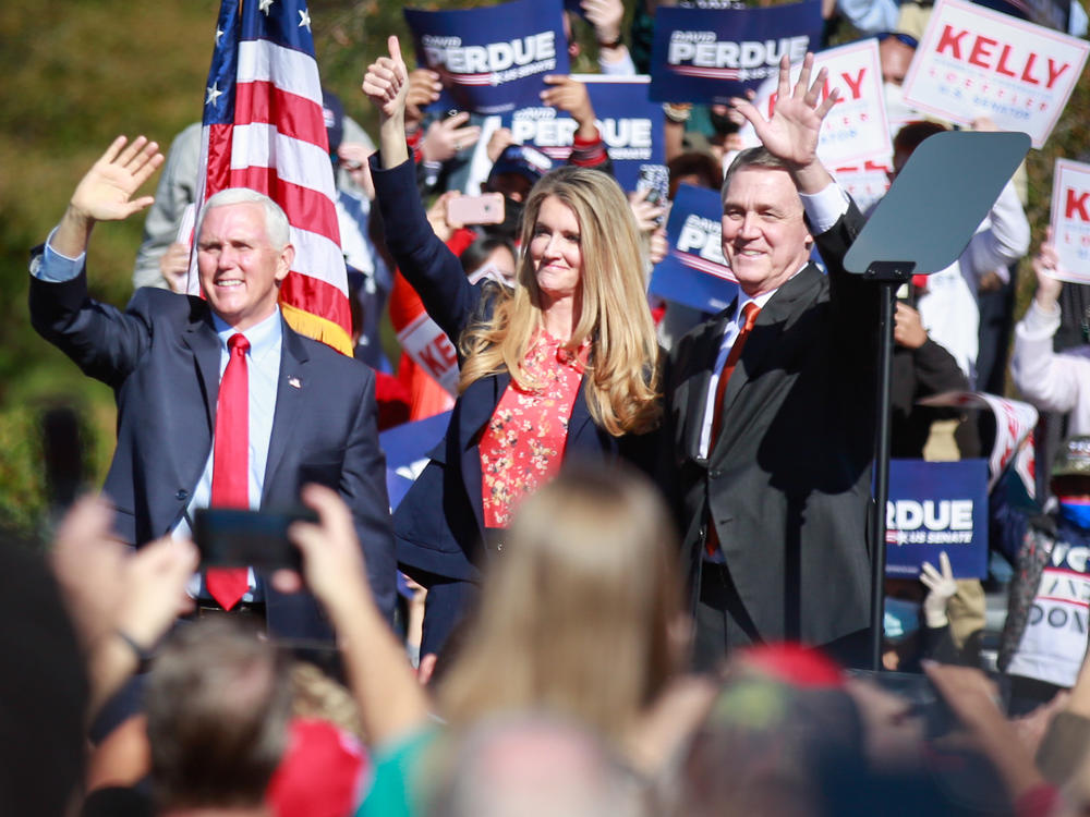 Vice President Pence waves to supporters during a Nov. 20 rally in Canton, Ga. Pence appeared alongside U.S. Sens. Kelly Loeffler and David Perdue. The Republican incumbents are defending their seats in a Jan. 5 runoff.