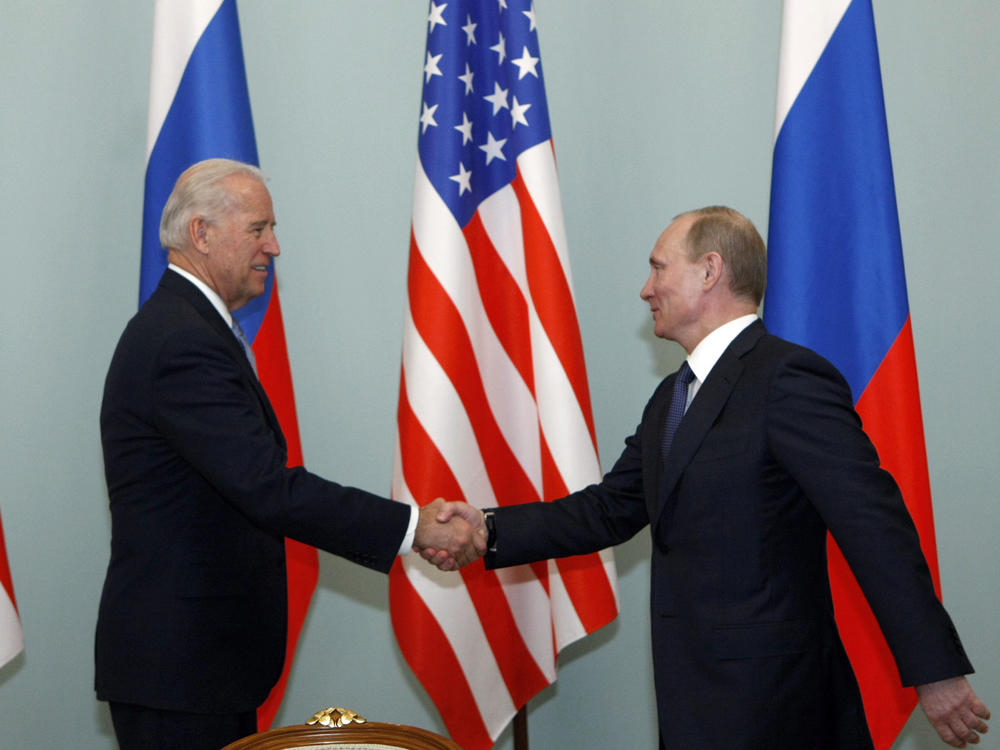 Putin, then Russia's prime minister, greets Biden, then vice president, in Moscow in March 2011. Biden has said he once told Putin he looked into his eyes and didn't see a soul.