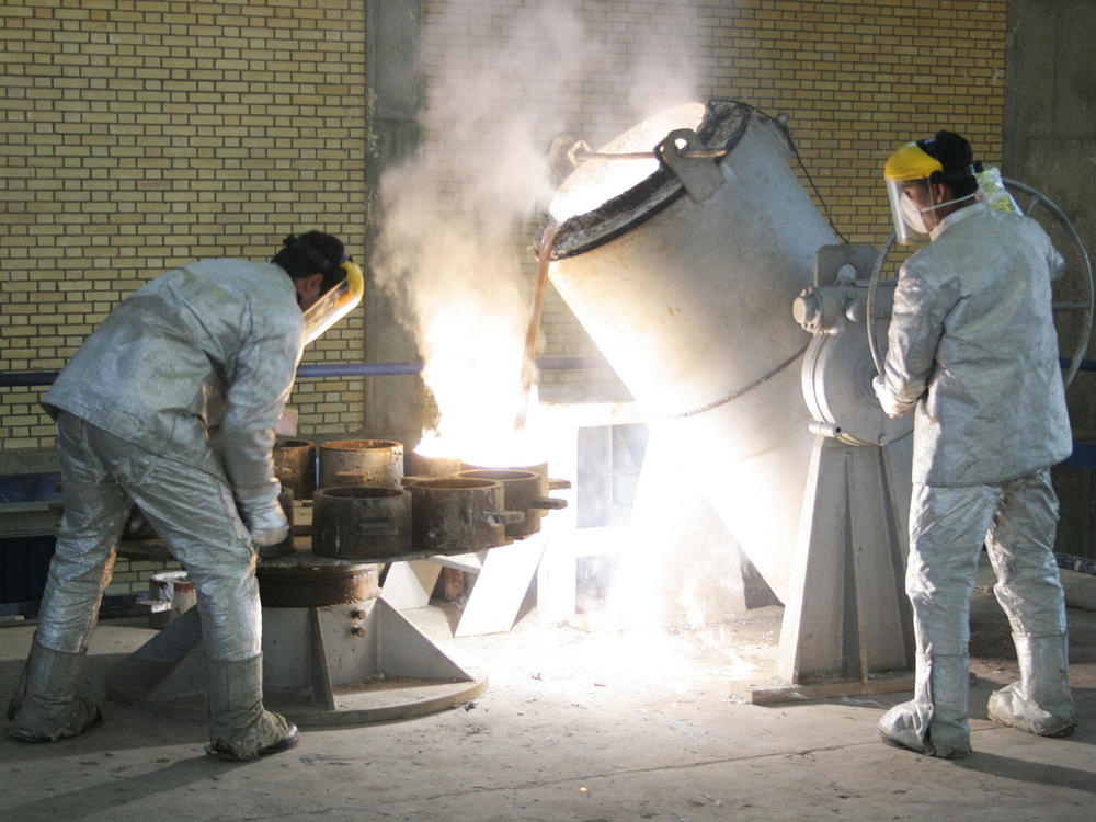 Technicians work inside of a uranium conversion facility producing unit in 2005 outside the city of Isfahan, Iran. After the 2015 Iran nuclear deal put limits on the program, Iran's government has been increasing uranium enrichment since the United States pulled out of deal.