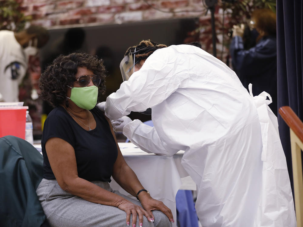 A resident of the Jackson Heights neighborhood in Tampa, Fla., got immunized against COVID-19 at St. Johns Missionary Baptist Church on Jan. 10.