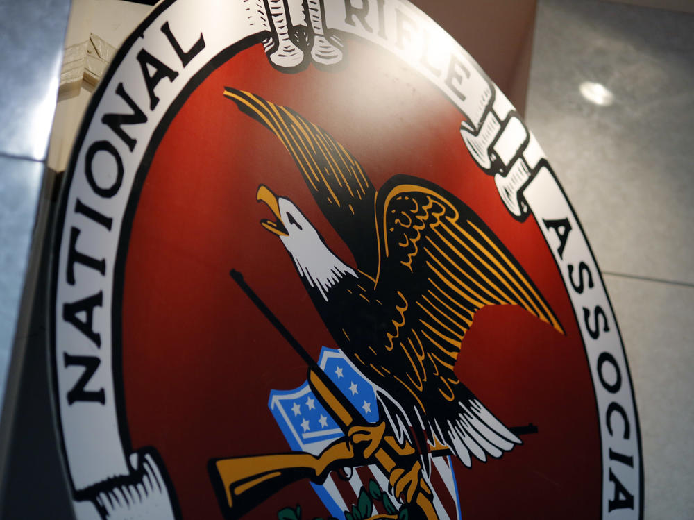 The logo of the National Rifle Association is seen at an outdoor sports trade show in 2017.
