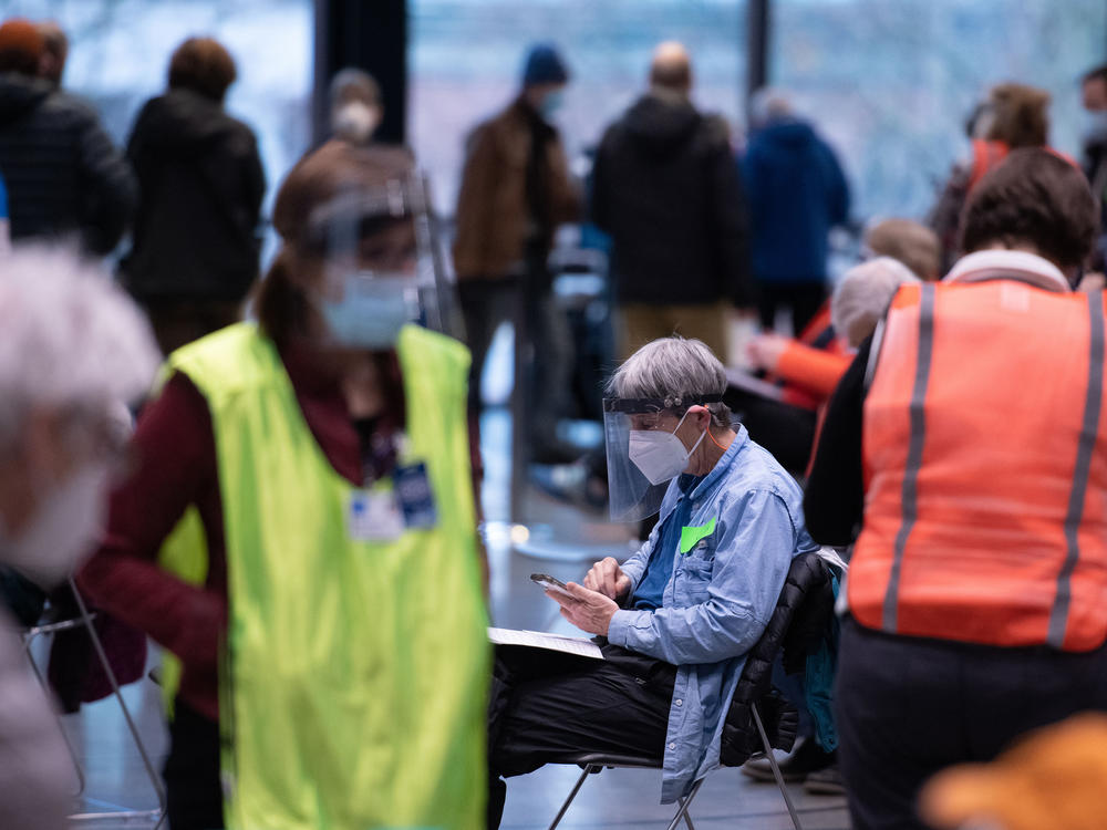 Workers and patients at a pop-up COVID-19 vaccination site near downtown Seattle in January.