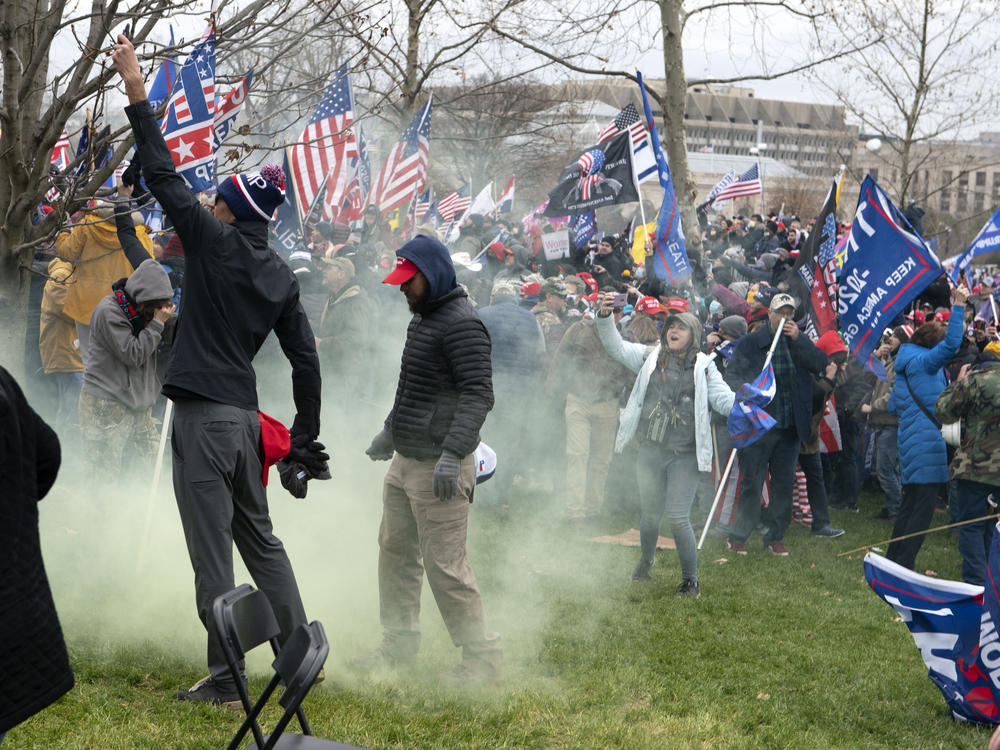 Supporters of former President Donald Trump protest as U.S. Capitol Police officers shoot tear gas during the assault on the Capitol Jan. 6.