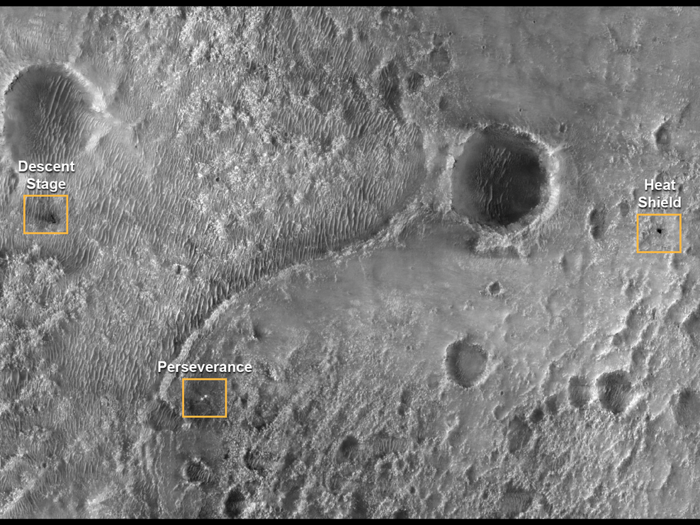 In this photograph taken by the Mars Reconnaissance Orbiter the various components of the Mars mission are seen on the planet's surface following landing.