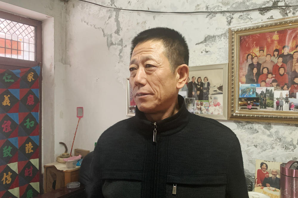Zhang Shuangshan, a security guard at Juxin Mining. He was sentenced to 5 1/2 years in prison. He alleged local police repeatedly beat him during an interrogation to force him to testify against his old boss, Zhang Zhixiong.