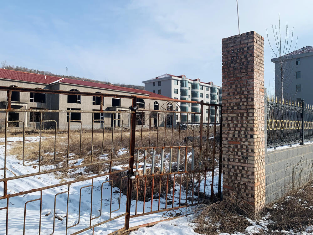 According to Zhang Zhixiong's family, Juxin Mining Co. paid for several village infrastructure projects, including building new apartment complexes for local residents. The buildings were weeks away from completion before Zhang was arrested and now stand abandoned in the middle of the village.