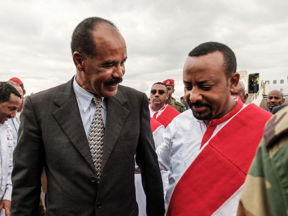 Ethiopia's Prime Minister Abiy Ahmed (right) welcomes Eritrea's President Isaias Afwerki upon his arrival at the airport in Gondar, for a visit in Ethiopia, in November 2018.