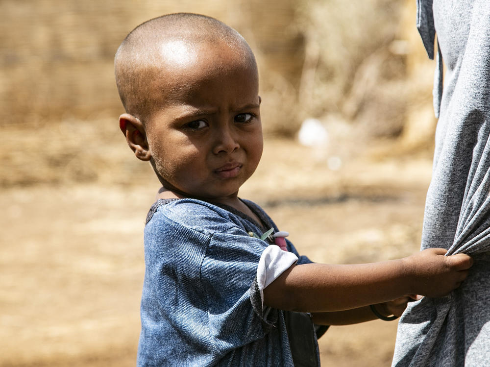 An Ethiopian child is seen at Um Rakuba refugee camp in February as those fleeing the conflict in Tigray continue to live under harsh conditions.