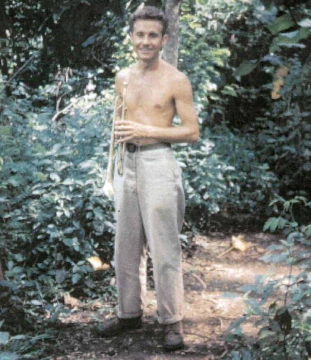 Richard Burt would walk into the jungle outside of camp to avoid waking other WWII servicemembers with his trumpet practice. Here, he returns from a practice session in 1945 in the Philippines.