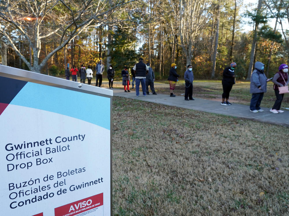 Voters stand in line to cast their ballots during the first day of early voting in the U.S. Senate runoffs at Lenora Park in Atlanta in December 2020.