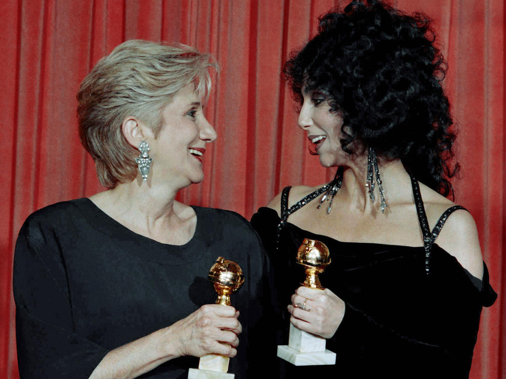 Olympia Dukakis and Cher hold the Golden Globe awards they received for performances in the hit movie <em>Moonstruck</em> in 1988. Later that awards season, they both won Oscars.