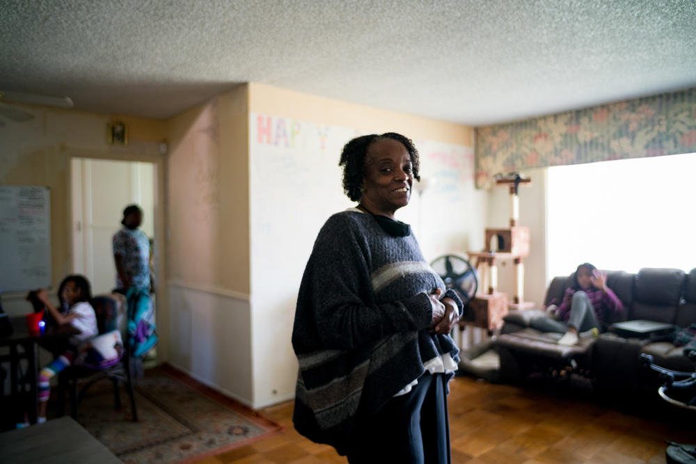 DonnaLee Norrington in her living room with grandchildren. Norrington and her younger sister MaryJosephine Norrington own a three-bedroom house in Compton, where three generations of her family currently live.