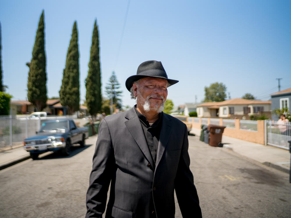 Robert Lee Johnson in his old neighborhood in Compton. Johnson remembers moving in one day in 1961.