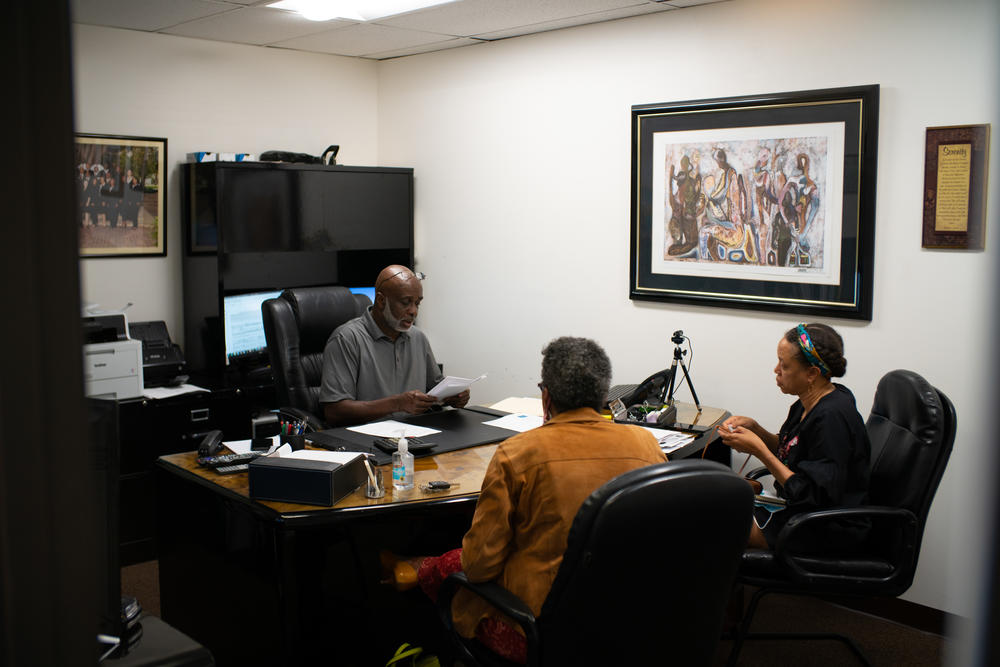 Mark Alston meets with clients at his office on La Tijera Boulevard in Los Angeles. <strong></strong>Unlike most loan officers, Alston works with his clients for months — even years — to disentangle a convoluted loan application process, pay off bills and boost credit scores so they can ultimately qualify for a home loan.