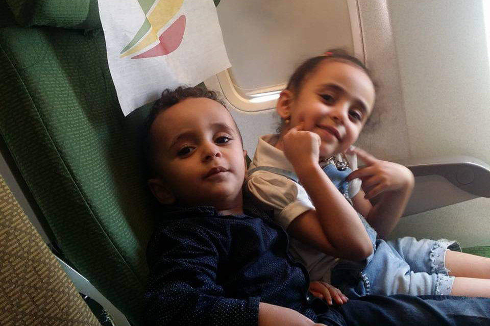 Alsaeedi's daughters Nada, then 6, and Mazeen, then 3, on a plane from Aden, Yemen, to Djibouti in 2017. They and their family traveled there hoping to complete the process to obtain visas that would grant them a new life in the U.S. but were turned back because of the Trump administration's travel ban.