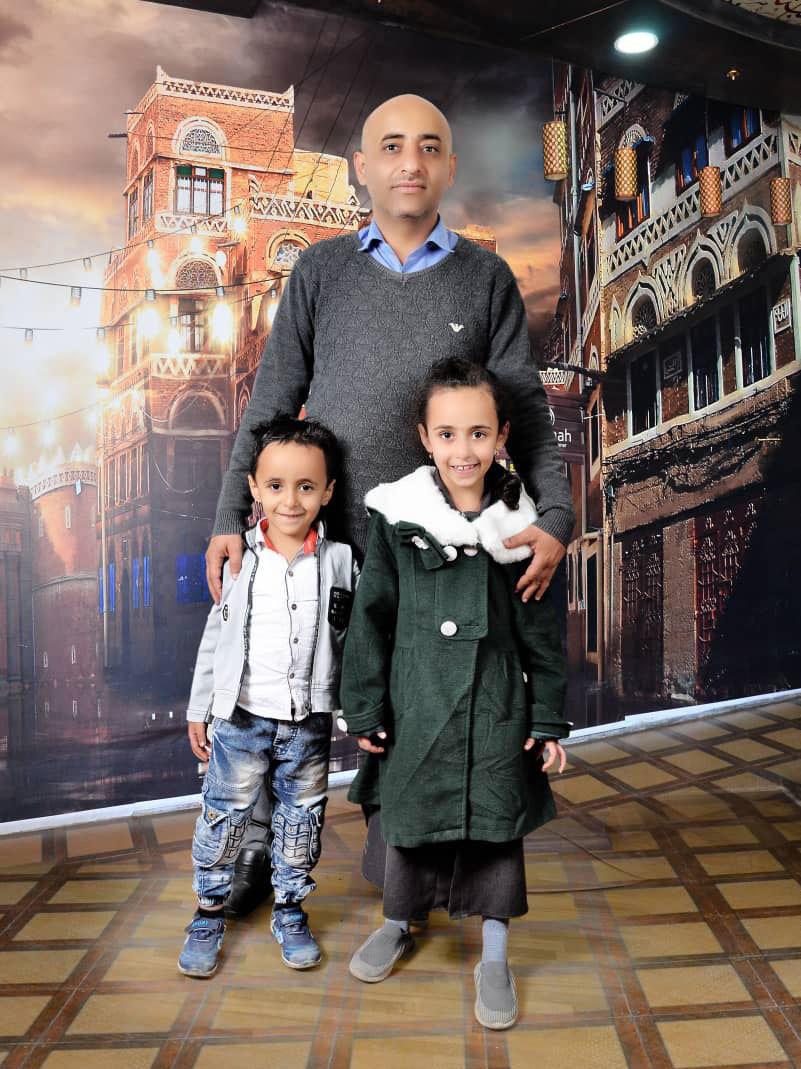 Anwar Alsaeedi stands with his children, Nada, 9, and Mazeen, 6, in Yemen's capital, Sanaa.