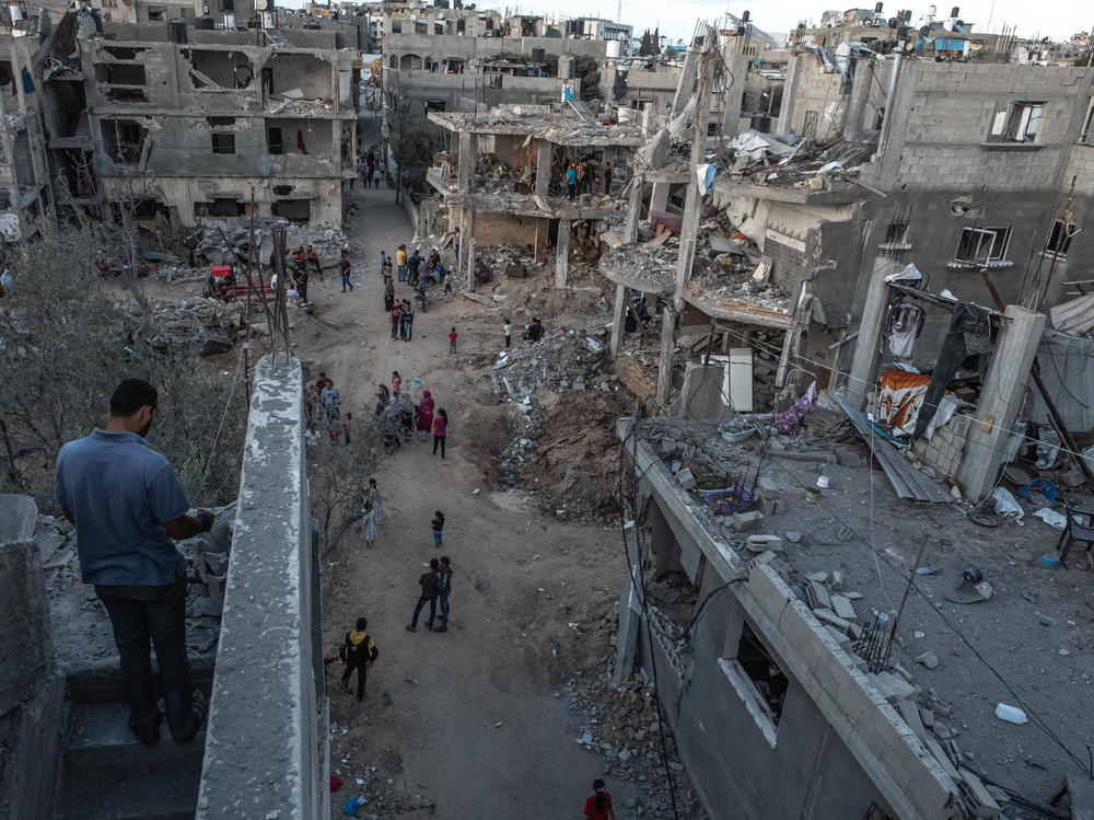 Palestinians inspect the rubble of their destroyed houses in Beit Hanun, northern Gaza Strip, on Saturday. The ceasefire between Israel and Hamas appeared to be holding.