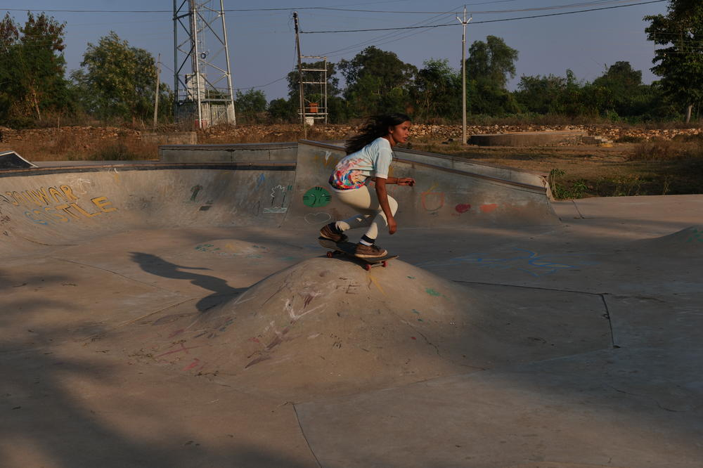 Asha Gond rides over an obstacle known as a volcano at the Janwar Castle skatepark in her village.