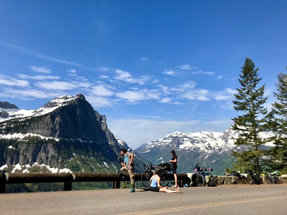 Cyclists take a break on Glacier National Park's Going-To-The Sun road.