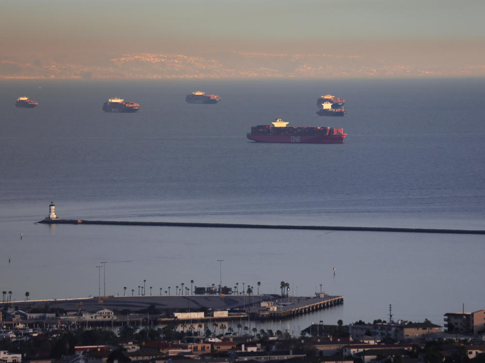 Container ships and tankers are anchored close to the ports of Los Angeles and Long Beach in February. The Port of Los Angeles logged its busiest month in history in May.