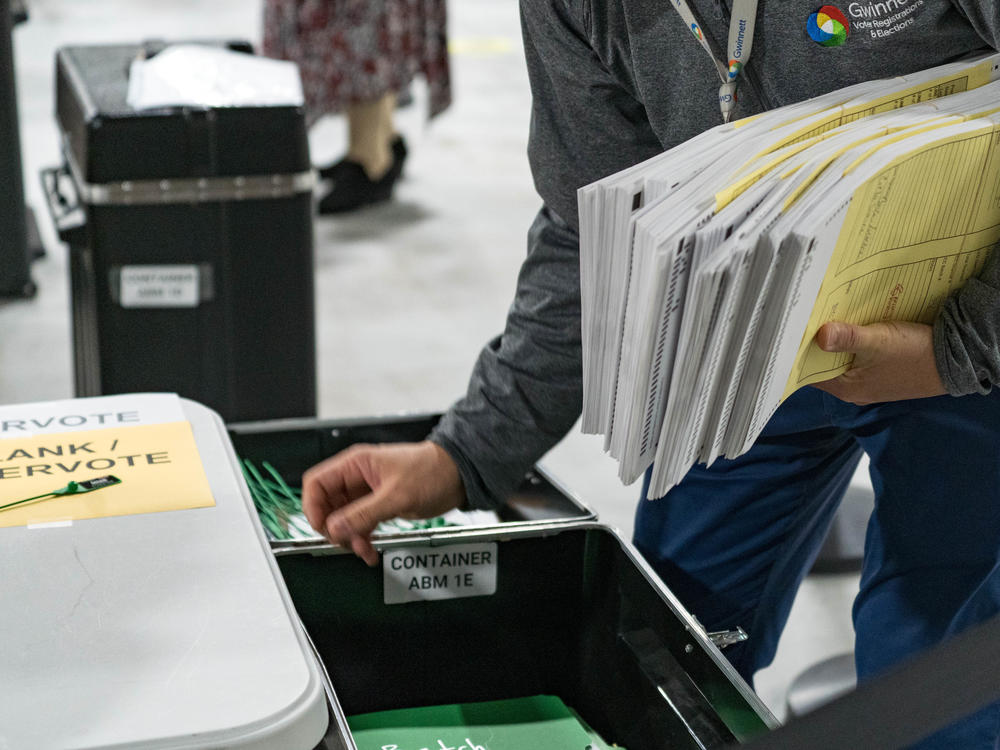 Georgia election workers begin their recount of ballots after the November election. Despite three recounts of the tally, former President Donald Trump and his allies falsely claim electoral fraud cost him the state.