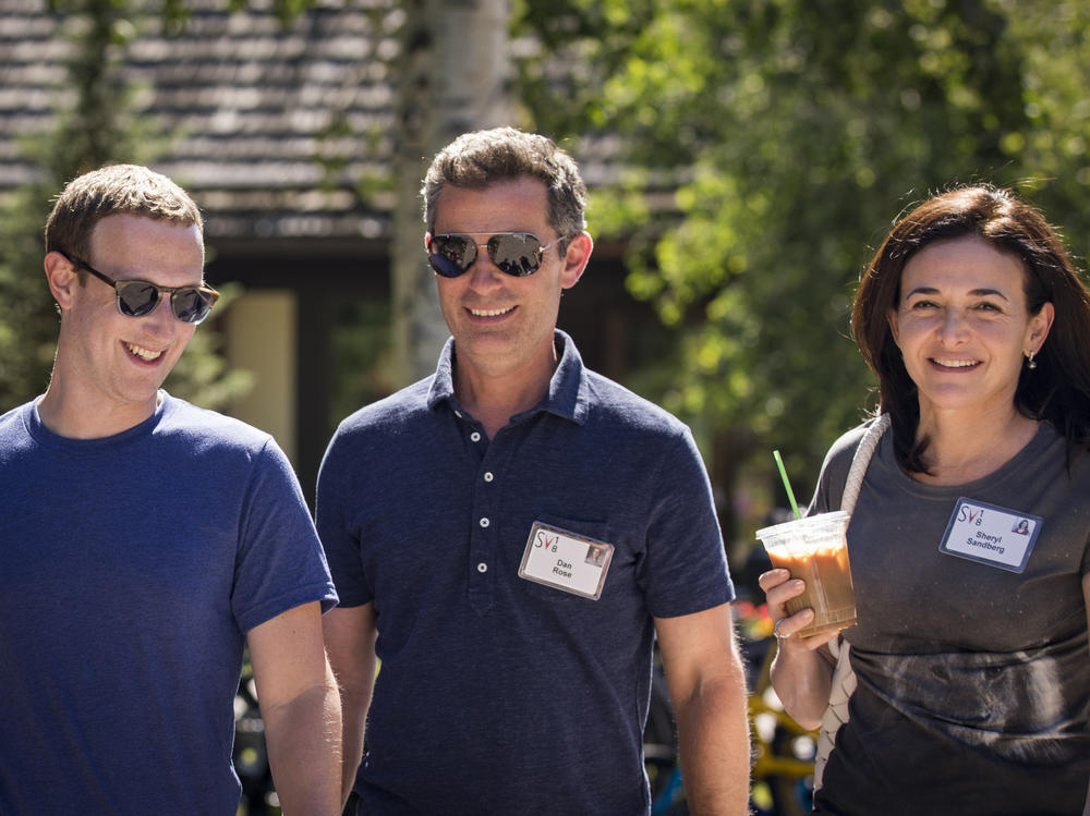 Facebook's CEO Mark Zuckerberg, Vice President of Partnerships Dan Rose and Chief Operating Officer Sheryl Sandberg walk together at the Allen & Company Sun Valley Conference on July 12, 2018 in Sun Valley, Idaho. Top tech and media moguls descend on the resort every year for a week of activities - and deals.
